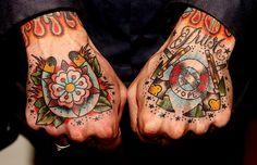 I'm not so much a fan of the hand tattoo but i love the horseshoe design.