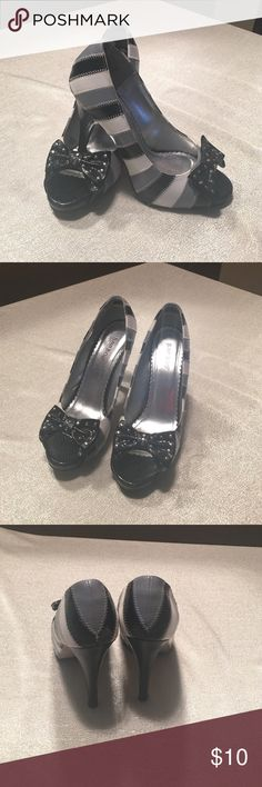 Black/White/Gray heels with BOW Cute gray white and black heels with bow in front. Chevron stitching. These are a size 8 but I'm typically a 7.5 and these fit me perfectly. Shoes Heels