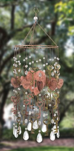 Such a cute windchime. Has large heart with keys cut out in the center, surronded by smaller hearts, keys, and acrylic gems.