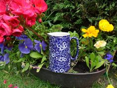 Blue Victorian Jug among the flowers.