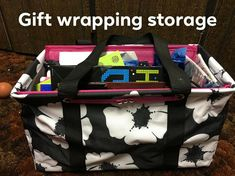 Wrapping paper storage in the medium utility tote.  Fits perfectly on most cube organizers and book shelves.