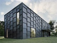 concrete shell with black-stained plywood shingles by Tham & Widegärd Hansson Arkitekter