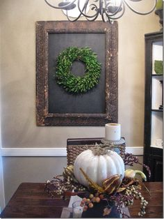 Here's the old frame my husband traced out the dimensions of the I taped that off and painted it with more chalkboard paint. I used one of my boxwood wreaths inside. I love the simplicity of the wreath against the black.