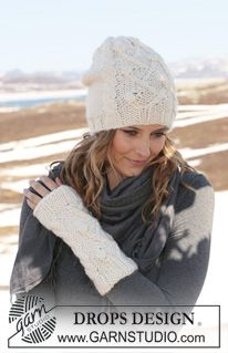 "Set comprises: Knitted DROPS hat and wrist warmers with cables in ""Eskimo"". ~ DROPS Design"