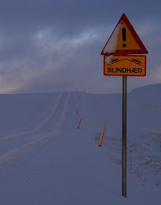 Drive with caution!!!!  You never know what might be on the other side of the hill --- is it a sheep, is it a car,, is it a reindeer!!! Noo... it is Santa!!!! :P Panoramio - Photos of the World