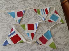 New Bunting Made this morning for my kitchen window, love the fabric scrap bin at the Haberdashery shop :)