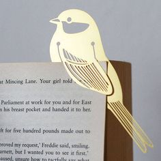 DIY Bird Bookmark  (but cut out of wood, not metal, on the laser cutter? -mh)