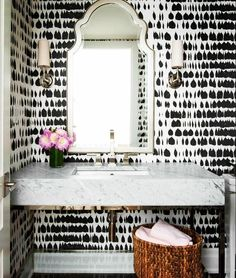 Black and white bathroom wall paper. This would look amazing on one wall and leaving all other walls white!