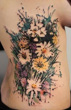 Blooming flower watercolor tattoo on back for girl