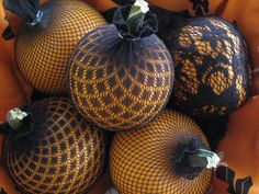 Sexy Pumpkins!  Use old black nylons around smallish pumpkins for a festive and different decorative look!  Tie the end where the stem is, but make sure the cute little stem sticks out over the top.   ~cam