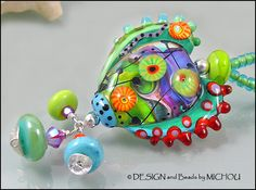"MICHOU Anderson Lampwork Jewelry - Glass Heart Pendant in green, purple and coral ""Happy go Lucky"". $93.00, via Etsy."