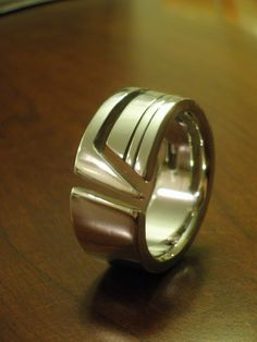hand crafted stainless steel mens ring. $220.00, via Etsy.