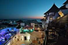 Experience uninterrupted views of the Emerald Coast skyline at the Havana Beach Rooftop Lounge, the exclusive rooftop lounge at The Pearl Hotel. Romantic Beach Getaways, Romantic Getaway, Panhandle Florida, Havana Beach, Rooftop Lounge, Beach Bars, Mansions, House Styles, Outdoor