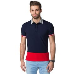 Handsome polo in a regular fit, crafted from pure cotton pique. Trendy, colour-blocked styling adds a fashion-forward twist. This short-sleeved polo stands out with stripes on the ribbed cuffs and accent-coloured polo collar. Tommy Hilfiger logo flag on the sleeve. Uneven vented hem. Our model is 1.86m and is wearing a size M Tommy Hilfiger polo.