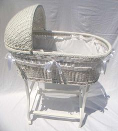 miniature wicker bassinet by Carolyn Lockwood . sculpy baby by Elizabeth Matatucci (even has two tiny teeth), tatted edging and bonnet by Esther Hargrove.