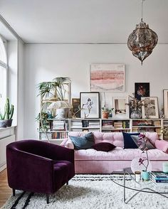 Lilac and aubergine neutral yet eclectic scheme...love that vintage chandelier and the gallery