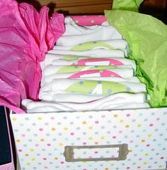 Baby Shower Gift -onesies to document each month of the first year. Cute to include mini scrapbook to insert picture from each month in!