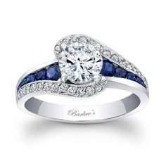 Blue Sapphire Engagement Ring - - This classic white gold sapphire and diamond engagement ring features a prong set round diamond center. The shoulders split and curve up to cradle the center with pave set diamonds, while channel set saphiress gr Diamond Rings, Diamond Engagement Rings, Diamond Cuts, Sapphire Diamond, Sapphire Rings, Emerald Rings, Ruby Rings, Morganite Engagement, White Sapphire