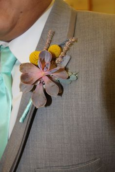 Boutonniere with pink succulent, & billy balls [crespedia]. Stem wrap to match groomsmen's mint green tie created by Diane from Emerald Iris Florals Wisconsin.
