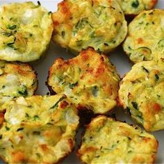 Zucchini Bites~T~ easy to make. I used cheddar cheese and some dried basil. Baked in mini muffin tins.