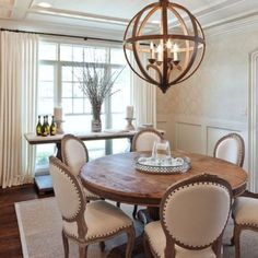 25 Beautiful Neutral Dining Room Designs   DigsDigs love the round table and the chairs, gives the room a nod to a European feel.