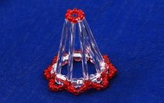 Time for bells. Simple and charming bell that anyone can do ... 1.  On the line threaded tube, red bead, tube, and 2 crystal beads, crucif...