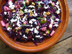 Forest Walk Cabbage Salad Recipe Salads with extra-virgin olive oil, purple onion, garlic, red cabbage, apples, fresh rosemary, golden raisins, balsamic vinegar, walnuts, fine sea salt, goat cheese
