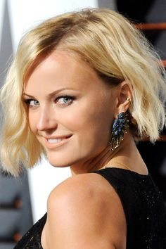 Malin Akerman nails the California cool-girl look by crimping her short hair and adding plenty of volume.   - HarpersBAZAAR.com