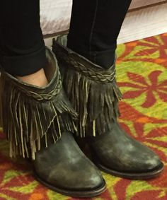 Boho inspired fringe booties.
