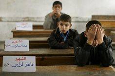 At a Palestinian school, on the note cards it's saying: the name of the dead classmate right next to them