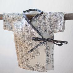 Alright a kimono is cute after all (even Martha Stewart has a tutorial: http://www.marthastewart.com/265396/baby-kimonos )