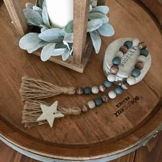 Wood bead garland with star and jute tassels, Gray, brown, and green farmhouse wood beads : Diy Tassel Garland, Wood Bead Garland, Beaded Garland, Garland Ideas, Bead Crafts, Diy Crafts, Decorative Beads, Farmhouse Style Decorating, Farmhouse Decor