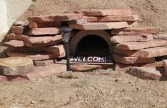 The finishing touches on my above ground burrow. I thought every tortoise deserved a porch light and a welcome mat.