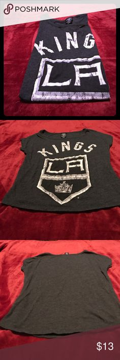 LA Kings loose fitted shirt! ❤ Go Kings Go! Show your NHL LA Kings pride with this awesome shirt! In great condition! Licensed NHL gear! Has a bit sparkle to it. This does fit big! ❤ LA Kings Tops Tees - Short Sleeve