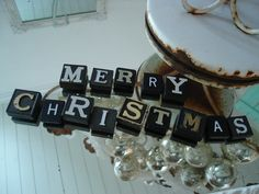 Love these old black wooden letters spelling Merry Christmas lying on a mirror!