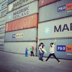 People jumping in front of shipping containers via Instagram