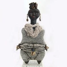 Symbolizing fertility, abundance and overall prosperity. The dolls held by young Namji girls (Namji tribe) to play and to ensure their fertility, are considered among the finest and the most beautiful dolls in Africa. They are carved from solid hardwood. The doll would have a name, be fed, be talked to and be carried strapped to the back...  This was the young girls' first baby... This doll helped prepare the young Namji woman for her role as mother in her future life.