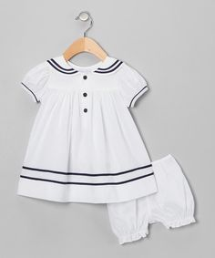 With its sailor collar and front button closures, this outfit's dress proves once and for all that darling is in the details. Quality cotton material and a versatile pair of bloomers are the final points that group comfortable coverage with a classically girlish fit.