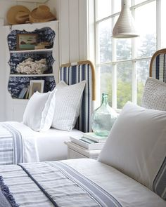 Twin bed decked out in navy & white   Riviera Headboard via Serena & Lily