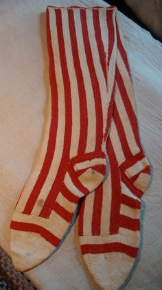 Wonderful 19th century ladies handmade striped socks. (Looking at a close-up on the website, these appear to have been knit sideways in four pieces, seamed together, and then the toes were either seamed on or knitted on.)