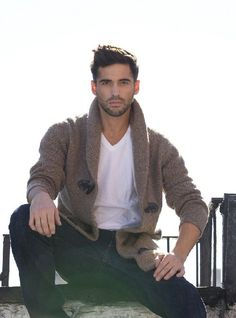 Shop this look for $114:  http://lookastic.com/men/looks/brown-shawl-cardigan-and-white-v-neck-t-shirt-and-navy-jeans/1439  — Brown Shawl Cardigan  — White V-neck T-shirt  — Navy Jeans