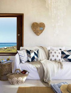 modern house. like the messy look of the sofa, and the stiched heart + touches of blue