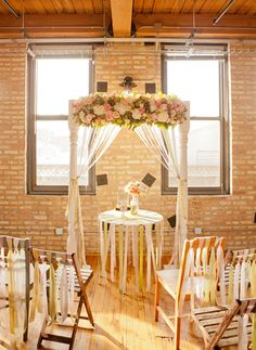 Top 10 Wedding Backdrop Ideas - Acquire an Arbor: If you don't know where to start, try using an arbor to provide some structure! Arbors work well in both large and small spaces, and you can customize them in a variety of ways. Use paint or a wood stain to give it a fresh look to match your wedding. Dress it up with some ribbon and flowers for a traditional display, or give it a distressed finish and tie a little burlap on for a rustic look. Photo from Elizabeth Anne Designs.
