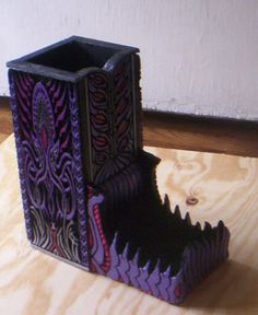 Cthulhu purple metallic dice tower by StudioZSculpture on Etsy, $49.99