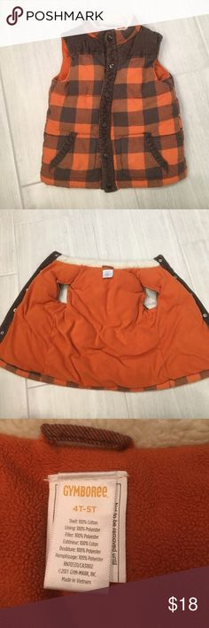 Gymboree orange and brown plaid vest Boys 4T-5T Gymboree orange and brown plaid vest with faux fur along collar. Warm, thick vest. Collar does have some pilling, which likely can be picked off. Vest is in great shape! Gymboree Jackets & Coats Vests