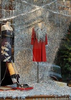 Anthropologie Christmas tinsel wall. Would be cool to cover a huge piece of MDF or something in Super 77 and tinsel strands for a huge focal point. #christmas #decor #anthro