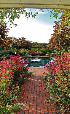 Flowers lining walkway Garden Bridge, Walkway Garden, Unique Gardens, Garden Photos, Pool Landscaping, Pathways, Terrace, Brick, Sidewalk