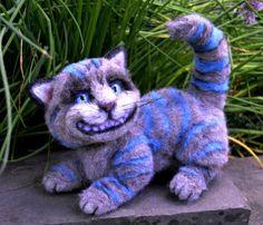 Le chat du Cheshire du Chessur frappant une pose coquine, toujours souriant avec un vrai sourire de Cheshire, ce pimpant tigré dans la mesure à 6 de haut et 10 de Long, 100 pour cent à l'aiguille feutré de la fibre d'alpaga. Orné de ciseaux à la main luxuriante sculpter alpace fibre teintée à la main pour faire la combinaison parfaite avec échappé gris. Yeux de verre bleu belle tohickon que l'air à travers vous et sont la dernière chose à disparaître. Sa fourrure de ciseaux à la main longue…