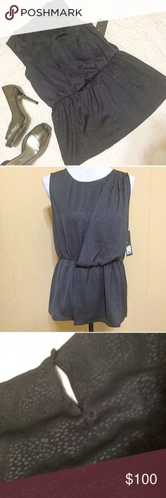 Reserved Soft and silky wrap-style peplum blouse is brand new and never worn. Features a drapey wrap front, a keyhole at back of the neck and a button, although it easily slips over the head without fooling with button. Dark gray with a subtle semi-metallic finish and an also subtle spotted animal print. Beautiful top, perfect for work work a pencil skirt, or with jeans for running weekend errands! Mossimo Supply Co. Tops