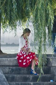 """Taylor Swift's red dress with white flower appliques and blue peep toes on """"Begin Again"""" clip"""